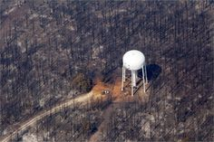 amazing, reminds me of something you'd see in Anime. An area destroyed by wildfire surrounds a water tower in Bastrop, Texas Bastrop Texas, Texas History, Water Tower, Color Stories, Personal Photo, Wind Turbine, The Neighbourhood, How To Memorize Things, World