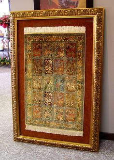 Large custom framed silk rug. Hand sewn to suede.This rug took the artist a year to weave. Custom framing by Centerville Framing and Gifts.