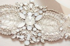 Nostalgic of precious jewelry, each MillieIcaro Sash is made from pearls, mounted swarovski crystals, and silk thread. Beautifully intricate, each sash emanates old Hollywood Glamor and vintage feel m