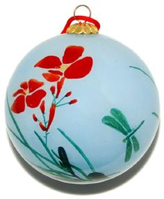 $15.99-$22.99 Ornament, Pale Blue with Dragonflies - CO187 - Dragonflies are symbols of courage, strength, and happiness, and they often appear in art and literature, especially haiku. Each hand-blown glass ornament is hand painted in reverse on the inside of the glass. Choosing from a selection of miniature curved shaft brushes, the artist hand paints each ornament in exquisite detail. Carefull ...