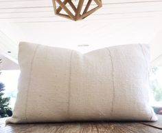 Authentic African White Mudcloth Textile Lumbar Pillow Cover 14x24 by INDIEbungalow on Etsy https://www.etsy.com/listing/260074918/authentic-african-white-mudcloth-textile