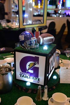 Football Themed Centerpiece Football Themed Centerpiece with Sports Equipment and Turf Base