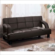"Sofa Kathy Ireland Caraway Sleeper Sofa by Kathy Ireland. $489.00. Color: Dark brown. Positions: Sleep, Upright. Dimensions: 73"" W x 35"" D x 33"" H. This Klik-Klak (sleeper sofa) with armrests can be used as sitting or sleeping surface and has bold tufting in a square pattern on the seat. Featuring luxurious Faux leather accented by the stitching style and the vibrant Dark brown colors that bring out the natural textures of the Klik-Klak, this Caraway Klik-Klak is sure ..."