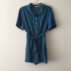 Belted Collared Romper from Urban Outfitters Belted shorts romper by Kimchi Blue from Urban Outfitters. It is lined so it is not see through. 100% polyester. Hand wash cold separately. Line dry. Do not dry clean. Excellent used condition. Urban Outfitters Shorts
