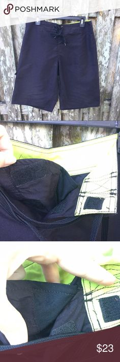Hang Ten brand board shorts waist 30 These black board shorts have only been worn a few times. They are a waist size 30. The waistband is neon green. There is only a pocket on the left hand size, and it Velcros closed. The fly similarly velcros closed, ties, and has an extra sticking or fabric to prevent ~accidents~ when waves take your shorts down- or the diving board! The Hang Ten logo is a pair of footprints, which is embroidered on the pocket. Hang Ten Swim