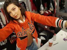 Bella Hadid in an Adidas bomber jacket