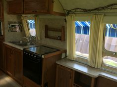 A before shot of the galley, those curtains will be coming down. The roll blinds will be saved and reused.