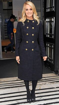 Carrie Underwood in a chic black coat - click through for more celebrity winter outfit inspiration