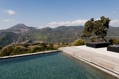 A salt-water pool, lined with black marble tiles. Photo: Stefano Buonamici for The New York Times