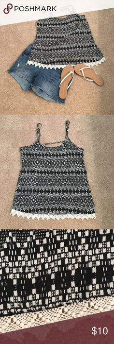 Aztec black and white tank Black and White Aztec Print tank with crochet Lace Trim at the bottom. Cute key hole back. Adjustable straps. Worn once. Upon inspection. I did notice the straps are sewn differently near the adjusters but it's not noticeable on. Only realized cuz I try to go over each garment fully before posting so there is no surprises for anyone!  It's super cute on just doesn't fit me right Mossimo Supply Co Tops Tank Tops
