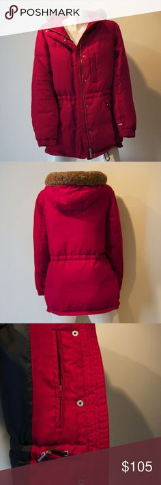 Red Down Jacket with Hood, Lots of pockets! Super warm, hardly used. Deep red outter fabric, down filling (60/40). Cinch waist and cinch bottom closure at hem. Faux fur lined hood. Double zipper and snap closure up the front. Two zip pockets at the hip. Small zip pockets at the left jacket breast on the inside and outside. One zipper pocket on the left forearm. I feel impervious in this thing :) length from top of shoulder to hem is about 28 inches. Width between shoulders is about 19 inches…