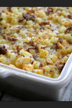 Cheesy Potato Breakfast Casserole 1 lb Sausage, 1 onion, chopped, 8 eggs, 1/2 c milk, 20 oz bag Ore-Ida Diced Hash Browns, 8 oz grated Cheddar Cheese, Salt & Pepper, to taste. Preheat oven to 350.Grease 9x13 dish.Brown sausage. Remove and saute onions in grease.In lge bowl, combine all ingredients. Pour into casserole dish.Reserve 1 c of cheese for topping. Bake 35-40 min.Remove from oven & top with reserved cheese. Return to oven for 8 min. Allow casserole to rest for 15-20 min.