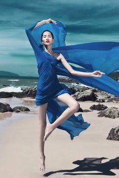 beach fashion editorial shot in thailand, dance, movement, blue