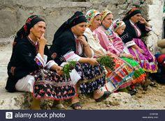 Women wearing traditional costumes at Vroukounta village, Karpathos, Dodecanese islands, Greece.