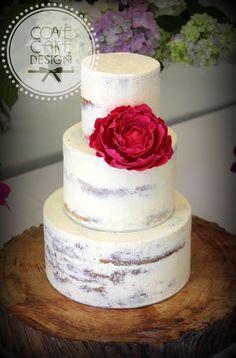 Semi-naked buttercream wedding cake with raspberry red sugar peony