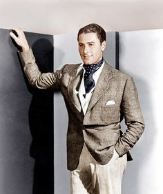 Errol Flynn, Ca. 1930s. And kudos to any man who can look that great in tights!