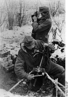 Panzer grenadiers of the Grossdeutschland division set up a machine gun position somewhere on the Eastern Front, Feb 1944.