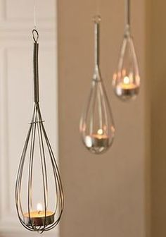 Whisk hanging candle holders.