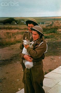 A.T.S Women With a Domestic Cat - HU014650 - Rights Managed - Stock Photo - Corbis. 1941.