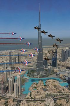 Red Arrows Airshow Dubai flying past the Burj Khalifa