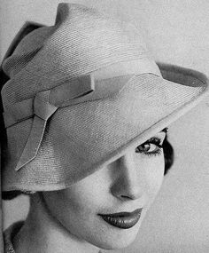 bded8696b3b Millie Perkins is wearing a mustard straw cloche by Lilly Dache