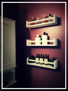 IKEA spice racks used to store small items in bathroom. Painted with Behr interior paint.