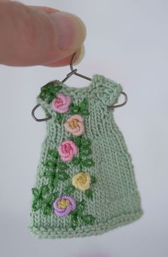 Bullion stitched roses on a teeny tiny hand knit dress for Amelia Thimble dolls.