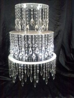 DISPLAY IDEA: DIY - add acrylic chandelier drops to a cake stand for total bling. String with fishing wire.