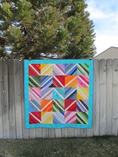 Rainbow string style quilt....red green blue by TreasuresByTami