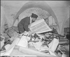 The Nazis stole art. The Monuments Men took it back.July 1945 Chaplain Samuel Blinder examines one of hundreds of Saphor Torahs, part of a cache of Hebrew and Jewish books that were stolen and collected from every occupied country in Europe. Nagasaki, Hiroshima, Fukushima, Jewish History, World History, Jewish Art, Army Chaplain, Monument Men, Vietnam