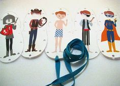 Printable lace-up boy! A spin on paper dolls. You print him, and all his different clothes, and then lace up the sides to make the clothes stay on