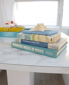 """Sneak Peek: Amelia the Airstream. """"What better way to relax when you are out camping then with a good book? During the remodel project I collected many books about the sea, fishing, boats and The Bobbsey Twins at the Seashore.I love all things vintage, and while the space is super fresh and modern, the small touches of old keep guests feeling right at home."""" #sneakpeek"""