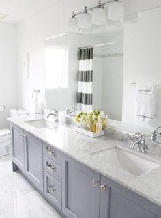 Love the light gray vanity + striped curtain