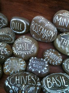Herb Markers - Hand paint plant names on smooth pebbles or rocks that double as attractive garden art - a simple handmade gift idea. 20 more easy low-cost DIY Plant Markers with tutorials @ http://themicrogardener.com/20-creative-diy-plant-labels-markers/ | The Micro Gardener