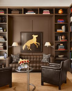 chocolate brown living room, benjamin moore french press, gold fox wall art, black accents, built-in bookshelves, tan carpet