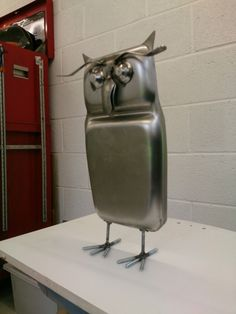 Metal owl, up-cycled materials