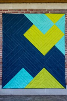 modern quilt in solids by Riane Menardi