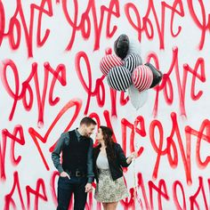 Vibrant love session with a graffiti wall, crafts from Studio DIY, and a heart inside of a cake by Mary Costa Photography!