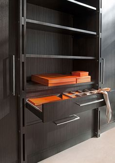 Closet system with open shelves and shallow drawers for small item storage: Kate Hume