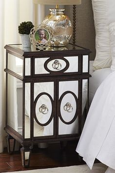 The Gabrielle Bedside Chest from Pier 1 has all the traits of a neoclassically inspired beauty. A drawer and a roomy interior provide premium storage space. Brushed-nickel hardware adds a muted shine. And a natural wood finish creates a casual, but stylish piece of decor.