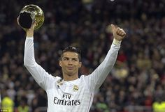 Real Madrid 2 - 2 Atlético de Madrid. The world's best player Cristiano Ronaldo shows off his Ballon D'or trophy to supporters before the game.