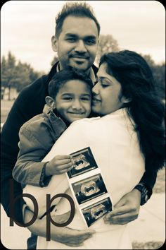 pregnancy announcement with sibling holding sonogram picture.