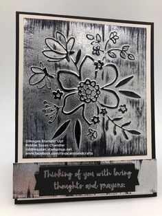 Black Ice technique. Lovely Floral Dynamic Embossing Folder with silver foil paper. Embossed the silver foil, swiped the black Stazon across the foil, then heat embossed clear embossing powder after using VersaMark.