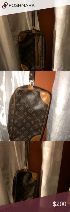 Louis Vuitton Large wristlet 10 3/8 ln 6in Height Preowned LV wristlet has a zipper pocket inside Bags Clutches & Wristlets