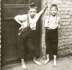 Britain's slumdogs: The ragged and filthy East End children of just 100 years ago living a life of grime