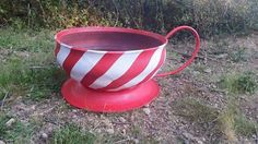 Recycled tire to a teacup planter from Beholders eye on facebook.