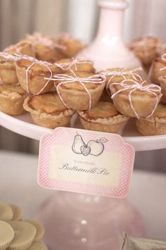 Mini pies wrapped in pink and white string bows. Sweets Indeed. Photography By / garrettdavisphotography.com, Floral Design By / primarypetals.carbonmade.com