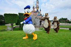 Donald, Chip, and Dale in front of Sleeping Beauty's Castle in Disneyland Paris
