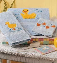 Craft these simple custom bath towels with appliques for a baby shower gift.