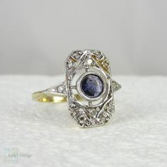 Vintage Panel Ring with Diamonds & Sapphire Blue Iolite set in White and Yellow Gold, Circa 1940s - 1950s.